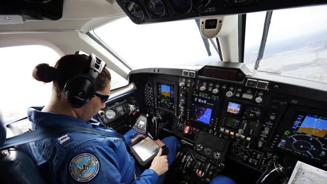 Pilot Lt. Rebecca Waddington checks the GPS during a National Oceanic and Atmospheric Administration flight to document coastal changes after Superstorm Sandy, Thursday, Nov. 1, 2012. (AP Photo/Alex Brandon)