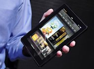 file photo, the Kindle Fire is displayed at a news conference, in New York. Apple has successfully fended off competitors who have tried to sell tablets in iPad's size range. But last year, Amazon.com Inc. figured out how to crack Apple's stranglehold on tablets by making a half-size, no-frills tablet. The result was the Kindle Fire, which sells for $199 -basically, the cost of production. Amazon has sold millions of them. (AP Photo/Mark Lennihan, File)
