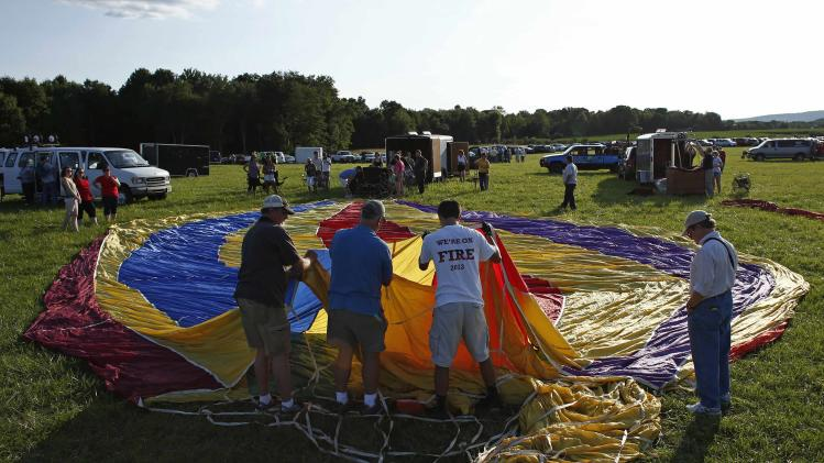 People prepare their balloon to fly in the 32nd annual QuickChek New Jersey Festival of Ballooning