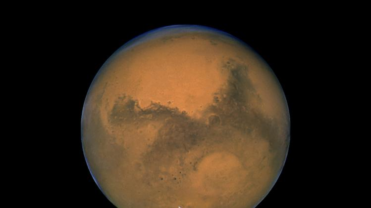 This Aug. 26, 2003 image made available by NASA shows Mars photographed by the Hubble Space Telescope on the planet's closest approach to Earth in 60,000 years. NASA's robotic rover Curiosity landed safely on Mars late Sunday, Aug. 5, 2012 to begin two years of exploration. The mission cost $2.5 billion. (AP Photo/NASA)