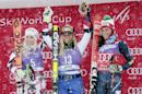 Switzerland's Lara Gut, center, celebrates winning the women's World Cup giant slalom ski race with second place finisher Austria's Eva-Maria Brem, left, and third place finisher Italy's Federica Brignone Friday, Nov. 27, 2015, in Aspen, Colo. (AP Photo/Nathan Bilow)