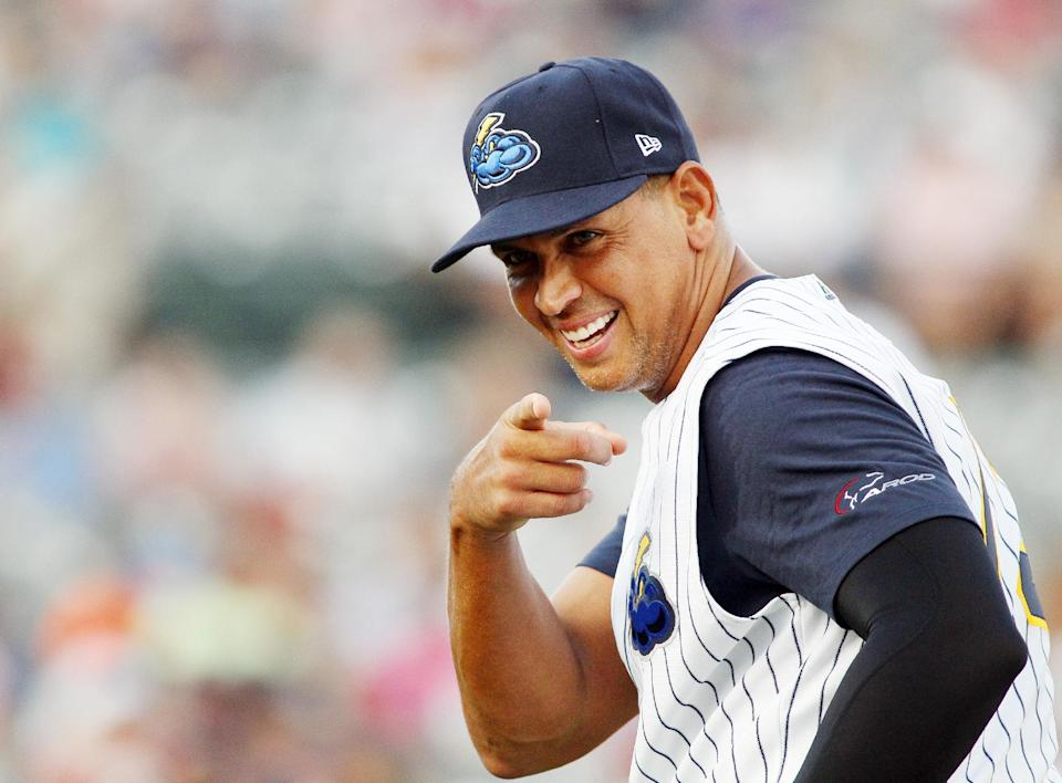 New York Yankees' Alex Rodriguez points towards a fan before the start of a Class AA baseball game with the Trenton Thunder against the Reading Phillies, Friday, Aug. 2, 2013, in Trenton, N.J. (AP Photo/Tom Mihalek)