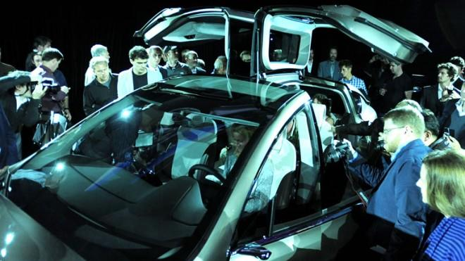 Tesla's innovative cars are drawing crowds.