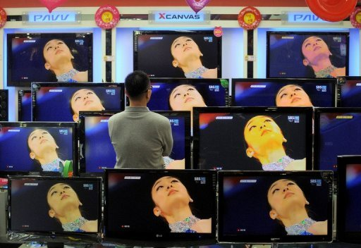 <p>File photo shows a man looking at televisions at an electronics store in Seoul. South Korea has drafted a new law aimed at restricting alcohol advertising amid mounting concerns over binge drinking and alcohol-related crimes, a government official said Thursday.</p>