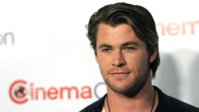 "Chris Hemsworth, star of the upcoming film ""Thor,"" poses during the opening night of CinemaCon 2011, the official convention of the National Association of Theater Owners,  Monday, March 28, 2011, in Las Vegas. (AP Photo/Chris Pizzello)"