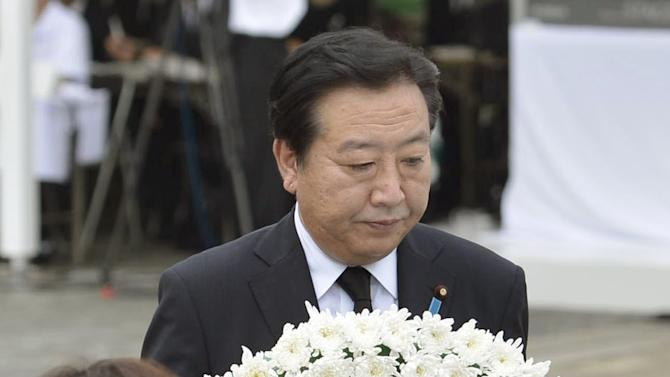Japan's Prime Minister Yoshihiko Noda offers a wreath during a ceremony held in front of the Statue of Peace at Nagasaki Peace Park in Nagasaki, southern Japan Thursday, Aug. 9, 2012 to mark the 67th anniversary of the world's second atomic bomb attack. (AP Photo/Kyodo News) JAPAN OUT, MANDATORY CREDIT, NO LICENSING IN CHINA, HONG KONG, JAPAN, SOUTH KOREA AND FRANCE