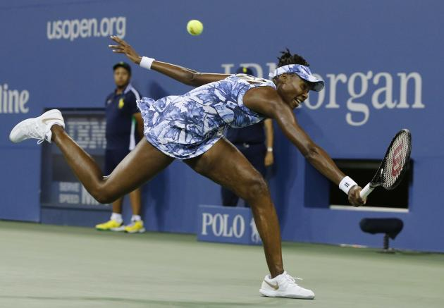 Venus Williams of the U.S. chases down a backhand to Timea Bacsinszky of Switzerland during their match at the 2014 U.S. Open tennis tournament in New York