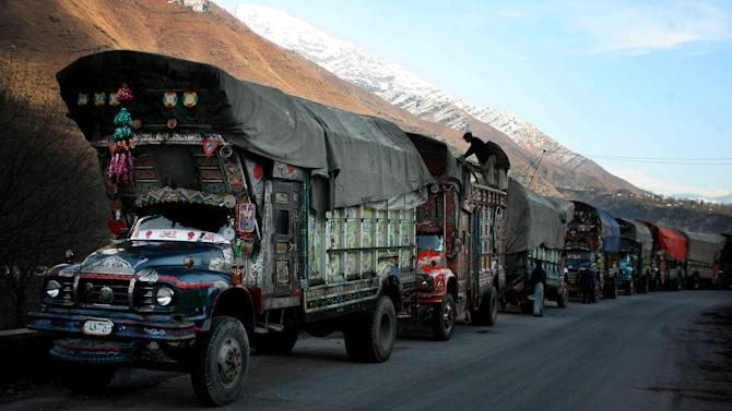 In this Saturday, Jan. 19, 2013 photo, Pakistani trucks carrying goods wait to enter Chakoti, 60 kilometers (37 miles) South of Muzaffarabad, capital of Pakistani Kashmir. Villagers are building bunkers, bracing themselves for more clashes in Kashmir along a fragile line of control that divides Pakistan and Indian after soldiers on both sides were killed in one of the worst flare-ups in tension in a decade. (AP Photo/M.D. Mughal)