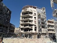 An image released by the Syrian opposition's Shaam News Network shows destroyed buildings in the restive city of Homs. AFP cannot independently verify this image. The