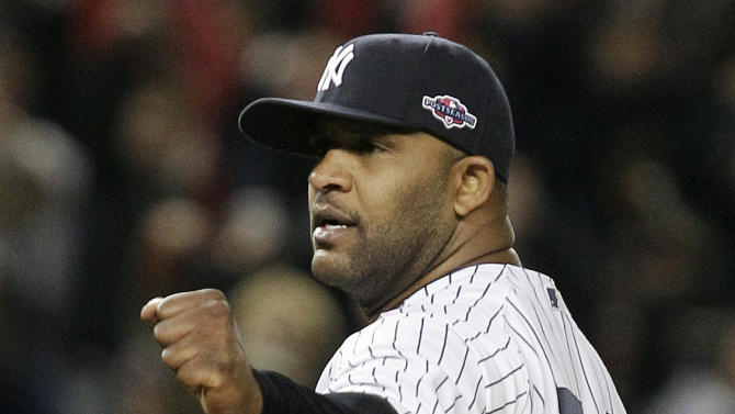 New York Yankees' CC Sabathia (52) reacts after Game 5 of the American League division baseball series against the Baltimore Orioles, Friday, Oct. 12, 2012, in New York. The Yankees won the game 3-1 and advanced to the AL championship. (AP Photo/Kathy Willens)
