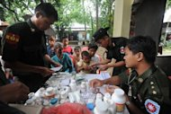 <p>Military medics are seen delivering medicine to Rakhine people at a monastery used as a temporary shelter for people displaced by days of sectarian violence in Sittwe, capital of Myanmar's western state of Rakhine. Fifty people have been killed and scores wounded in fresh communal clashes in the restive area, according to state media.</p>