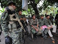 Moro Islamic Liberation Front rebels inside their base at Camp Darapan, Sultan Kudarat province, on the southern Philippine island of Mindanao
