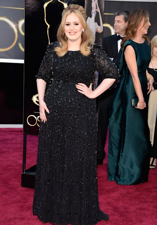 Adele played it safe on the Oscars 2013 red carpet in a black sparkling gown Getty