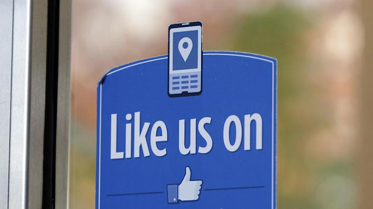 "FILE - In this Dec. 13, 2011 file photo, a sign with Facebook's ""Like"" logo is posted at Facebook headquarters near the office for the company's User Operations Safety Team in Menlo Park, Calif. A study by researchers at Cambridge, published Monday, March 11, 2013 in the Proceedings of National Academy of Sciences, has found that clicking the social network's friendly blue ""like"" buttons may reveal more about people than they realize. (AP Photo/Paul Sakuma, File)"