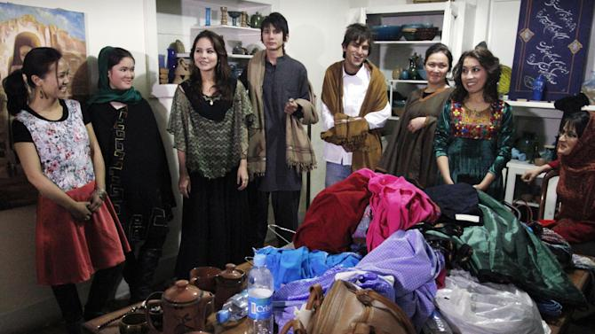 Afghani models are seen backstage after presenting a fashion show in Kabul, Afghanistan, Friday, Feb. 8, 2013. The rare fashion show in this war-weary capital was a small production but a big idea — part of an Afghan group's efforts to empower women by breaking down barriers in this highly conservative Muslim society. (AP Photo/Musadeq Sadeq)
