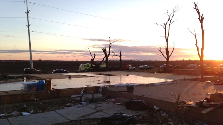 A fire truck and other vehicles lineup near what was left of Curt Zehr's home about a mile northeast of Washington, Ill., on Sunday, Nov. 17. Intense thunderstorms spawning tornadoes swept across the Midwest on Sunday. (AP Photo/David Mercer)