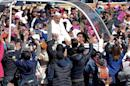 Pope Francis waves from the popemobile on his way to the cathedral, in Mexico City on February 13, 2016
