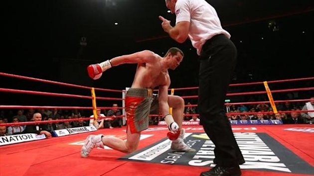 David Price of Great Britain is knocked down by Tony Thompson of USA and the referee stops the contest in round two during the International Heavyweight Fight between David Price and Tony Thompson at the Echo Arena on February 23, 2013
