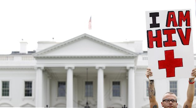 Aaron Laxton gathers in front of the White House in Washington, Tuesday, July 24, 2012, during an AIDS demonstration, Tuesday, July 24, 2012, as the AIDS conference continues in Washington. Laxton was