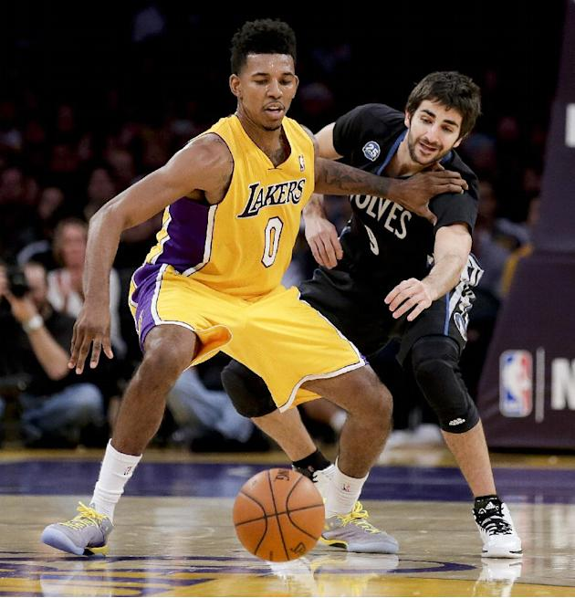 Los Angeles Lakers forward Nick Young, left, battles Minnesota Timberwolves guard Ricky Rubio for a loose ball during the second half of an NBA basketball game in Los Angeles, Friday, Dec. 20, 2013
