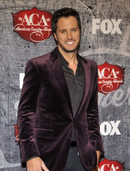 FILE - In this December 10, 2012, singer Luke Bryan arrives at the American Country Awards in Las Vegas. Co-hosts Blake Shelton and Luke Bryan also will perform during this year's Academy of Country Music Awards airing live on April 7, 2013 on CBS. The country cut-ups are among the first round of performers announced Wednesday, March 6, 2013, for the Las Vegas annual awards show and will be joined by Shelton's wife, Miranda Lambert, George Strait, Kelly Clarkson, Hunter Hayes and The Band Perry. (Photo by Jeff Bottari/Invision/AP, File)