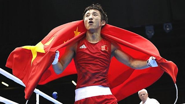 China's Zou Shiming celebrates Olympic gold (Reuters)