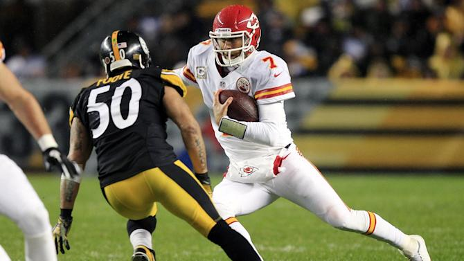 Kansas City Chiefs quarterback Matt Cassel (7) scrambles as Pittsburgh Steelers inside linebacker Larry Foote (50) pursues in the second quarter of an NFL football game in Pittsburgh, Monday, Nov. 12, 2012. (AP Photo/Gene J. Puskar)