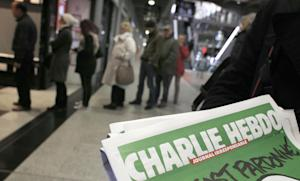 People queue up to buy the new issue of Charlie Hebdo …