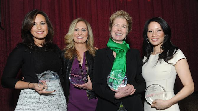 Actress Mariska Hargitay, left, WE tv President and General Manager Kim Martin, second left,  documentary filmmaker Lisa F. Jackson, second right, and actress Lucy Liu pose together after being honored at the 32nd annual Muse Awards presented by New York Women in Film & Television (NYWIFT), Thursday, Dec. 13, 2012, in New York.   (Diane Bondareff/Invision for NYWIFT/AP Images)