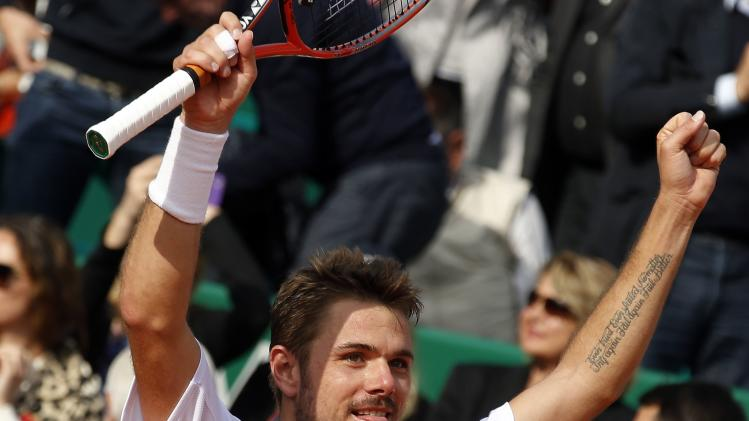 Wawrinka of Switzerland celebrates after winning the final match against his compatriot Federer at the Monte Carlo Masters in Monaco