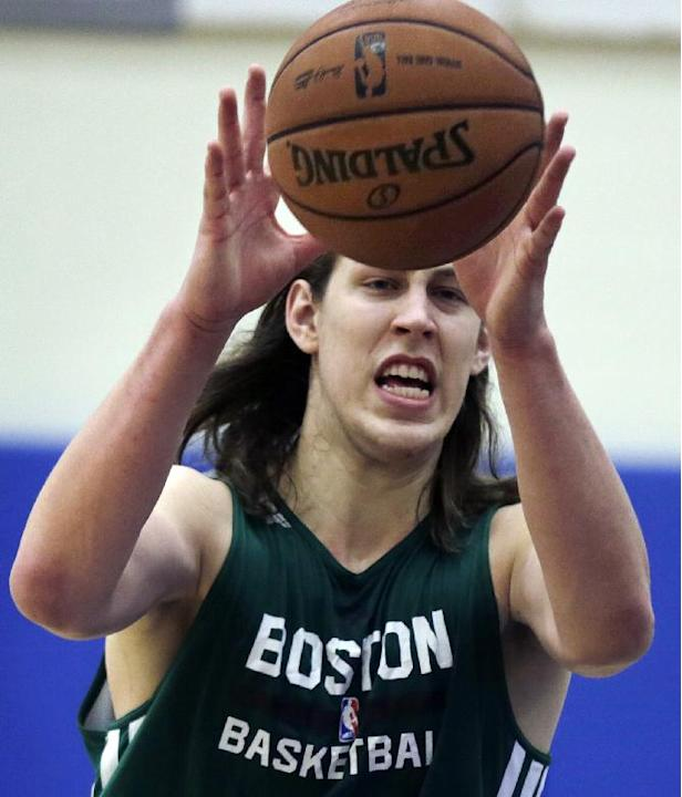 Boston Celtics forward Kelly Olynyk grabs a pass during their NBA basketball training camp at Salve Regina University, Wednesday, Oct. 2, 2013, in Newport, R.I