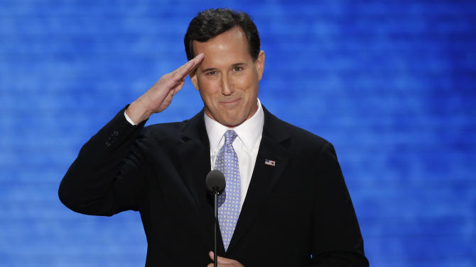 Former Pennsylvania Sen. Rick Santorum salutes his son during the Republican National Convention in Tampa, Fla., on Tuesday, Aug. 28, 2012. (AP Photo/J. Scott Applewhite)