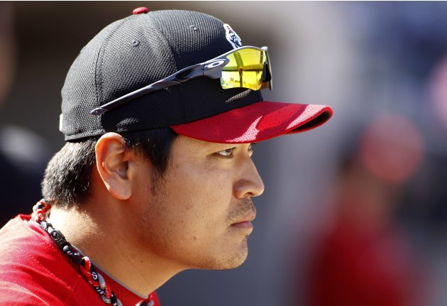 Reds' Shin-Soo Choo looks on during their MLB Cactus League spring training baseball game against the Diamondbacks in Scottsdale