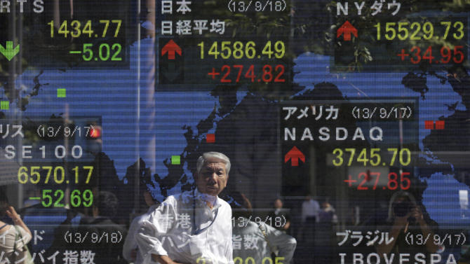 Asia stocks jump, Fed refrains from stimulus cut