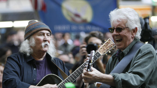 "FILE - In this Nov. 8, 2011 file photo, singers David Crosby, left,  and Graham Nash perform at the Occupy Wall Street encampment at Zuccotti Park in New York.  Music is woven into the fabric of Occupy Wall Street, much like when civil rights protesters sang ""We Shall Overcome"" or 1960s demonstrators heard ""Blowin' in the Wind"" or ""Give Peace a Chance."" Crosby and Nash's manager sent an email to Occupy Wall Street's website asking if the musicians could perform. (AP Photo/Mary Altaffer, file)"