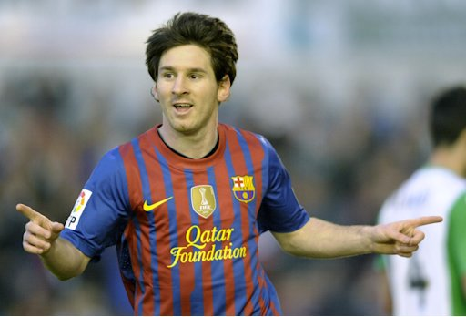 FC Barcelona's Argentinian forward Lionel Messi celebrates after scoring a goal during the Spanish league football match Racing vs Barcelona, at El Sardinero Stadium in Santander. Messi continued his rich vein of form with a double as Barcelona beat Racing Santander 2-0 on Sunday, but the champions remain 10 points off leaders Real Madrid.