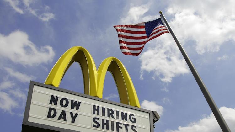 FILE- This May 2, 2012, file photo shows a sign advertising job openings outside a McDonalds restaurant in Chesterland, Ohio. McDonald's Corp. reports quarterly financial results before the market opens on Friday, Aug. 19, 2013. (AP Photo/Amy Sancetta, File)