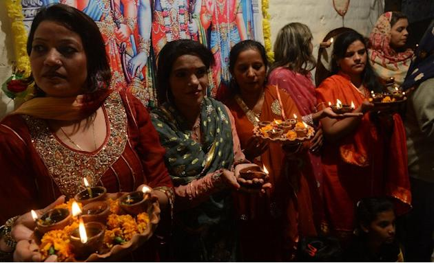 Pakistani Hindus carry oil lamps on the occasion of Diwali in Lahore on November 13, 2012. Diwali, the festival of lights, is celebrated with jubilation and enhusiasm as one of the biggest Hindu festi