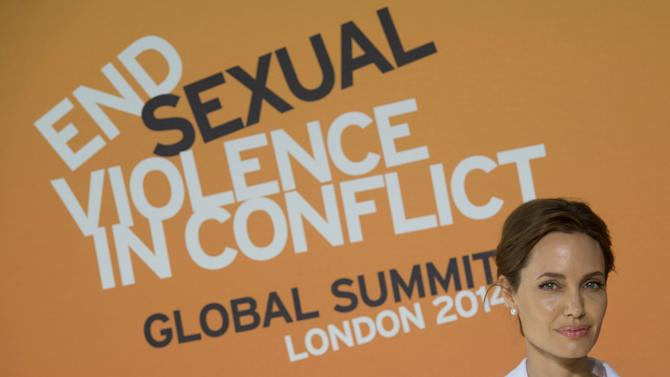 Actress Angelina Jolie arrives at the 'End Sexual Violence in Conflict' summit in London. Actress Angelina Jolie and British Foreign Secretary William Hague are hosting a four-day summit on sexual violence in war zones, attended by officials from over 100 countries. The summit, starting Tuesday, aims to identify ways to improve investigation of sexual violence and provide support for women and girls. (AP Photo/PA, Stefan Rousseau) UNITED KINGDOM OUT: NO SALES: NO ARCHIVE