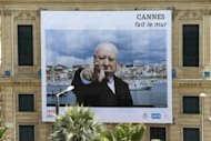 A giant photograph showing US film director Alfred Hitchcock hangs on a building, on May 12 in Cannes, southeastern France, four days ahead of the start of Cannes film festival. Arthouse directors and Hollywood royalty will converge on the French Riviera for two weeks from Wednesday as the Cannes Film Festival rolls out the red carpet for the giants and mavericks of the movie galaxy