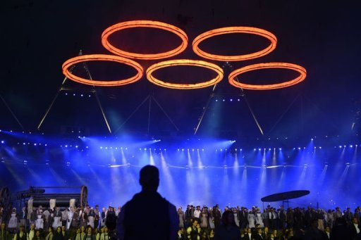 The Olympic rings float above artists performing during the opening ceremony