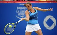 Roberta Vinci of Italy hits a return to Ana Ivanovic of Serbia during round two of the Rogers Cup at the Uniprix Stadium, on August 9, in Montreal, Quebec, Canada. Ivanovic suffered her first ever double bagel loss, crashing out to Vinci, 6-0, 6-0