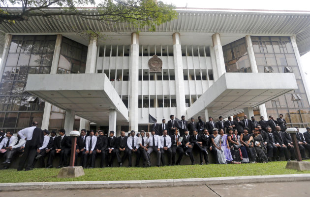 Sri Lankan lawyers sit in protest against the government's impeachment bid to remove chief justice Shirani Bandaranayake at the court complex building in Colombo, Sri Lanka, Friday, Jan. 11, 2013. The