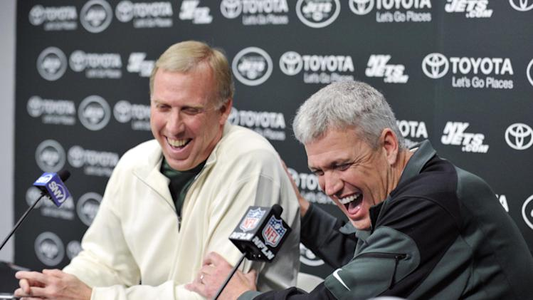 New York Jets coach Rex Ryan, right, and general manager John Idzik react as they speak to the media during an NFL football news conference Tuesday, Dec. 31, 2013, in Florham Park, N.J. (AP Photo/Bill Kostroun)