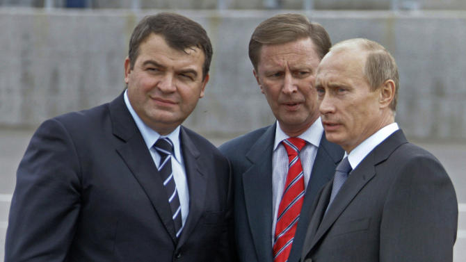 FILE - This Oct. 12, 2007 file photo shows from left : Russian Defense Minister Anatoly Serdyukov, Russian First Vice Premier Sergei Ivanov and President Vladimir Putin  speaking during a visit to Vilyuchinsk submarine base at the Kamchatka Peninsula at Russian Far East. Russian President Vladimir Putin, right, listens to  Kremlin's Chief of Staff Sergei Ivanov during a meeting at the Novo-Ogaryovo residence outside Moscow. Ivanov said Sunday Nov. 11, 2012 he was aware of alleged embezzlement of state funds by officials in a company developing Russia's satellite navigation system for several years, but didn't speak publicly about it for several years to prevent the culprits from covering up their deeds. (AP Photo/RIA Novosti, Mikhail Klimentyev, Presidential Press Service)