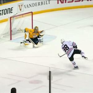 Kane rifles a shot past the glove of Rinne