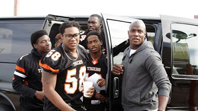 IMAGE DISTRIBUTED FOR DURACELL - Dallas defensive lineman DeMarcus Ware leads Lancaster Tigers captains to rally the community to attend their playoff game this Thursday on Tuesday, Nov. 13, 2012inLancaster, Texas. DeMarcus joined Duracell Trust Your Power program to encourage youth to realize their power to achieve their goals. (Photo by Brandon Wade/Invision for Duracell/AP Images)