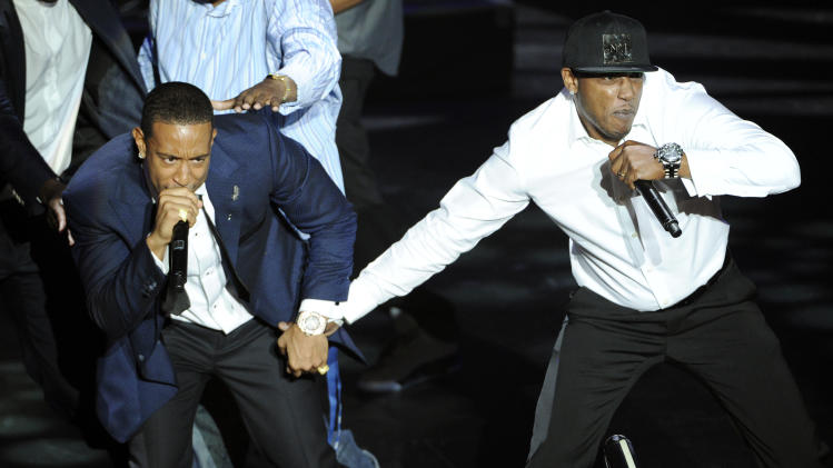 """BMI President's Award recipient Christopher """"Ludacris"""" Bridges, left, is joined onstage by rapper Mystikal as he performs at the 2014 BMI R&B Hip Hop Awards at the Pantages Theatre on Friday, Aug. 22, 2014, in Los Angeles. (Photo by Chris Pizzello/Invision/AP)"""