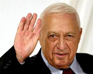 -FILE PHOTO 10MAR05- Israeli Prime Minister Ariel Sharon gestures at the end of his Likud Party's wo..