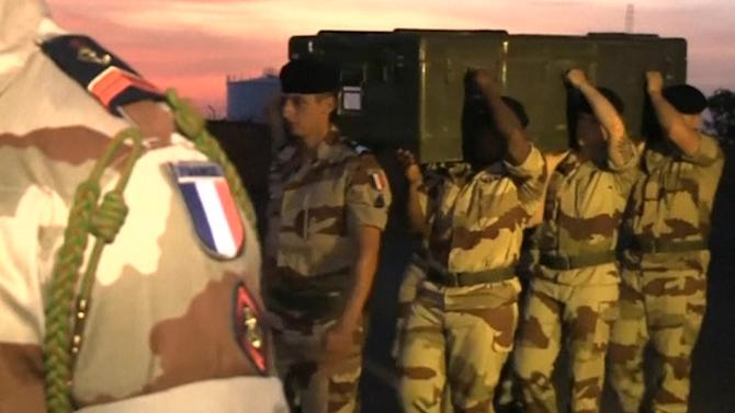 Coffins of slain French journalists leave Mali